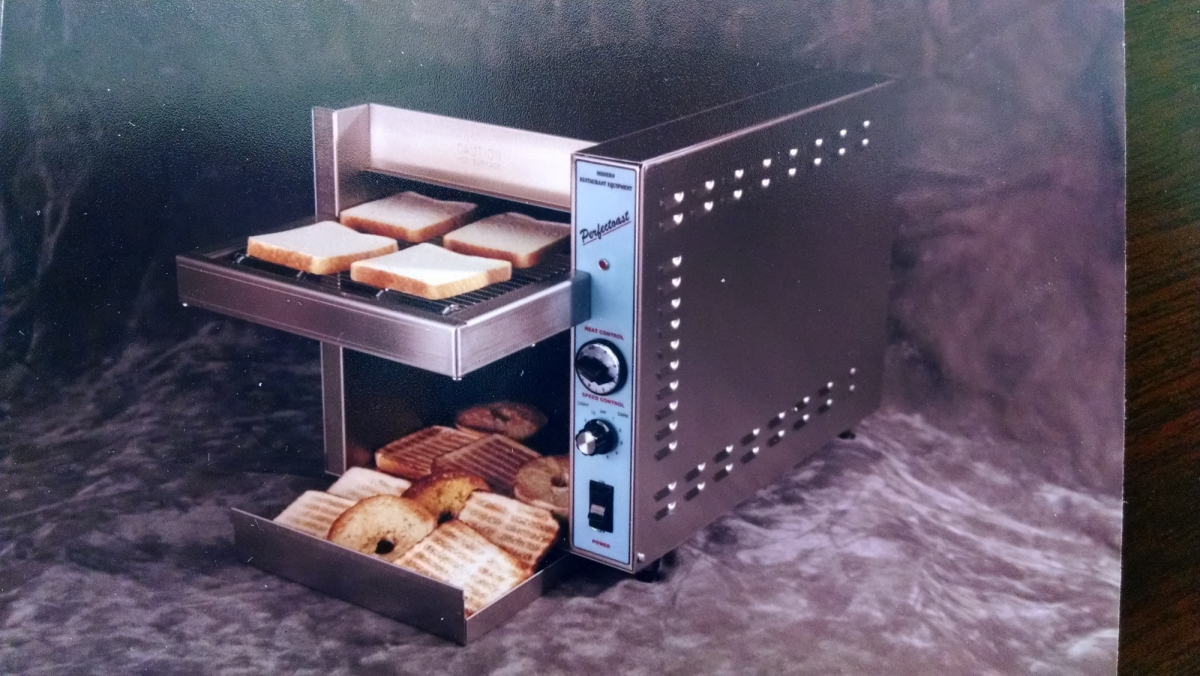 Our commercial toaster for sale full of bread and beagels